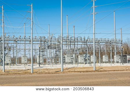 A rural, three phase, electrical power substation.