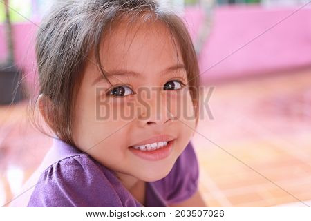 Asian girls are smiling happily in concept of health and cute.