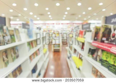 BLUR IMAGE OF THE BOOKSTORE . .