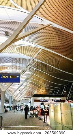 Shanghai, China - Nov 6, 2016: Interior departure area of Shanghai Pudong International Airport. This is a modern facility. People walking about the compound.