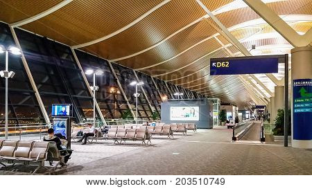 Shanghai, China - Nov 6, 2016: Departure lounge of Shanghai Pudong International Airport. This is a modern facility. A few people around about the compound.