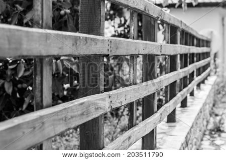 rural summer village with wooden fence B&W picture. Abstract picture