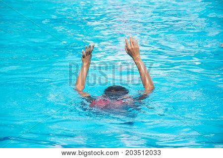 people drowning show two hand victim in the pool water