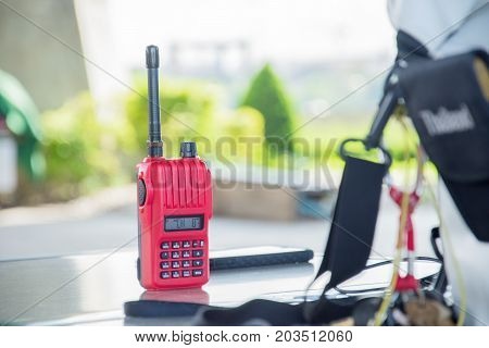 Transceiver color red for communication put on the desk blur background