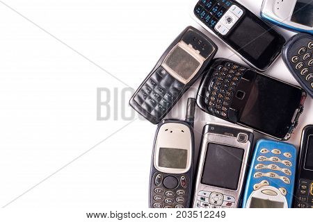 old and obsolete cellphone on a white background. Free space for text
