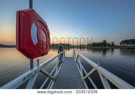 Modern public Life Buoy on a pier along river in the Netherlands