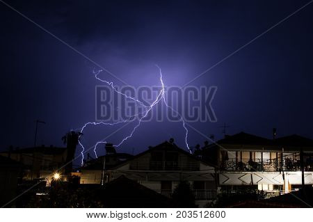 Lightning Display Over Houses In Greece