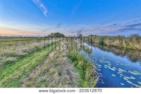 Path By River In Onlanden