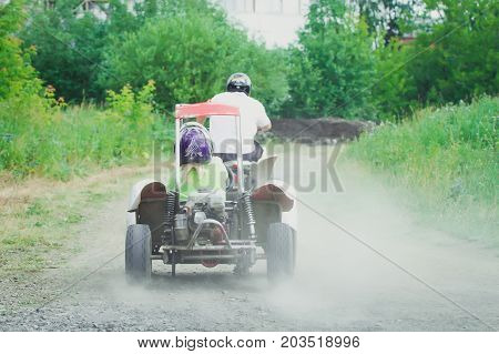 Man driving off-road with quad bike or ATV.