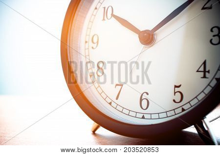 Closeup of Retro alarm clock with twelve o'clock. Time is indefinite continued progress of existence events that occur in apparently irreversible succession from past through present in to the future