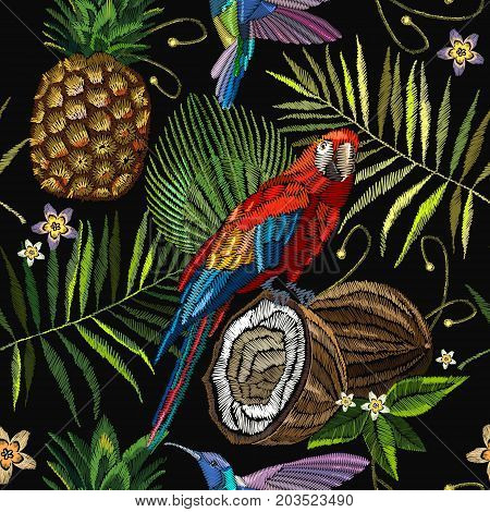 Embroidery parrot humming bird palm tree leaves pineapple coconut tropical seamless pattern. Fashionable embroidery tropical summer background. Template for design of clothes