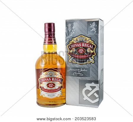 Ternopil Ukraine - August 26 2017: Bottle of Blended scotch whisky Chivas Regal. 12 years old scotch whiskey. Made in Scotland. Bottle of whisky with box isolated on white.