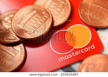 Brest Belarus - September 9 2017: Macro shot of Mastercard credit plastic card with new logo and penny coins