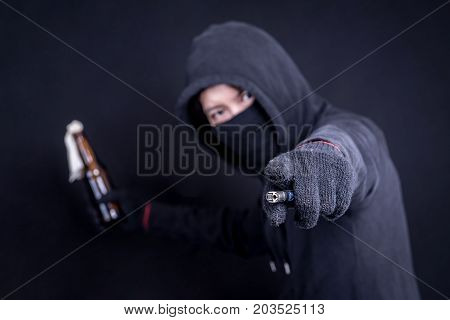 Protester with Molotov cocktail as known as petrol bomb or bottle bomb. With black screen and lighter.