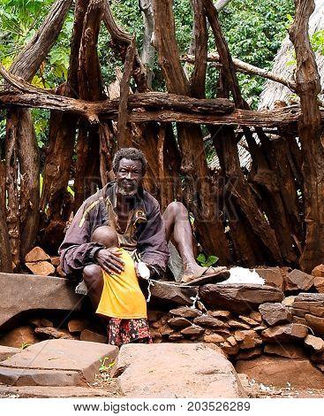 Konso aka Xonsita tribe man with baby in national dress - 03 october 2012 Omo valley Ethiopia