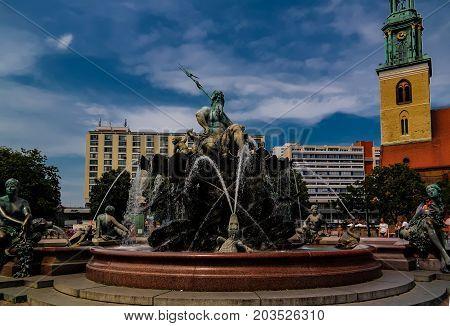 Fontain an statue of Neptune - 26-07-2016 Alexanderplatz. Berlin Germany