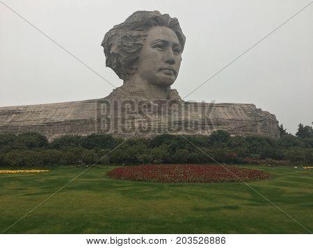 Changsha Hunan China , 1 February 2017 : Mao Zedong sculpture in orange Chau Tau island, Changsha City, Hunan Province, china