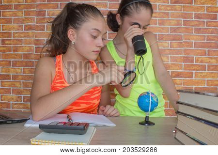 Two Girls working on his homework. young attractive student Girls studying lessons. Thoughts education creativity concept
