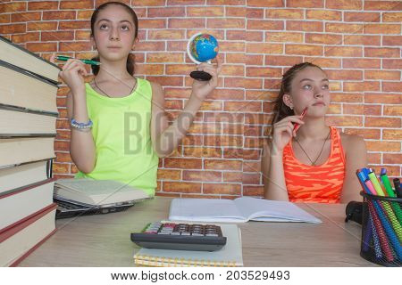 Two young attractive student Girls studying lessons. Education and school concept
