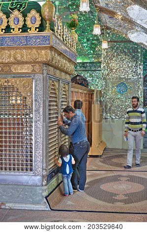 Fars Province, Shiraz, Iran - 18 april, 2017: Muslims pray in Sayyed Alaeddin Hossein Mosque, worship of Mirrored mausoleum.