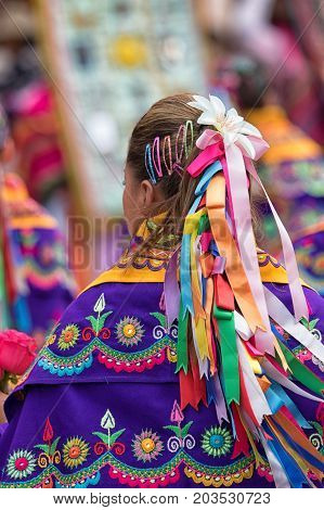June 17 2017 Pujili Ecuador: colourful hair decoration and clothing of a woman at the Corpus Christi annual celebration in the Andean town