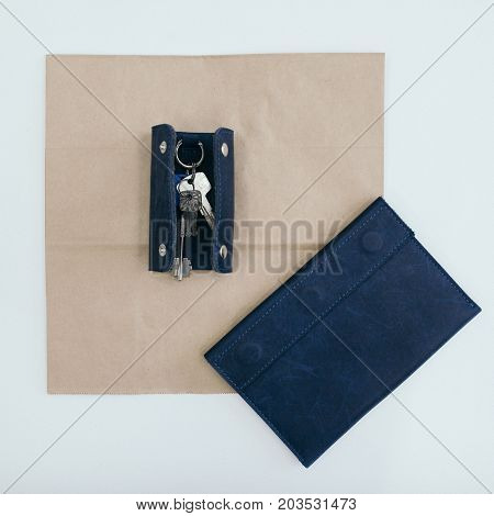 Blue purse with keys. paper and white background.