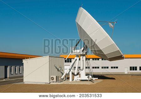 Satellite Earth Station Dish. TV antenna in communication center