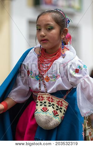 June 17 2017 Pujili Ecuador: indigenous kichwa girl in traditional clothing participating at the annual Corpus Christi parade in the high altitude Andean town