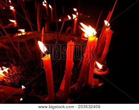 Burning candles in a pot for background