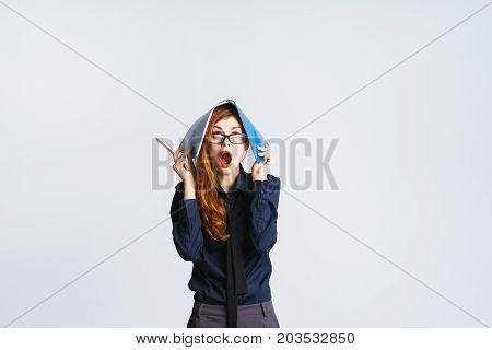 The woman is tired of work. Looks up. Isolated on white background