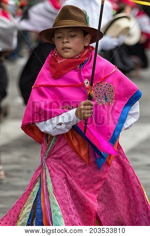 June 17 2017 Pujili Ecuador: young indigenous boy in bright colour traditional clothing at Corpus Christi parade