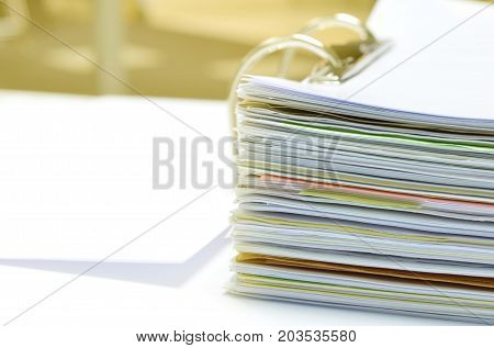Stack of financial documents in document file on desk at workplace,business concept.