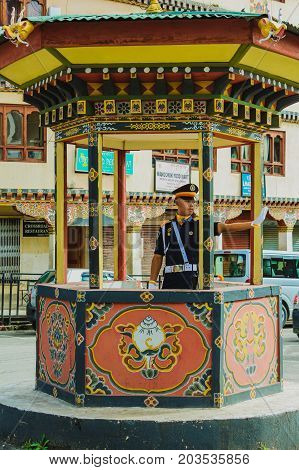 Thimphu Bhutan - September 10 2016: Traffic control police officer directs traffic in the streets of Thimphu Bhutan. Thimphu is the world's only capital without traffic lights.