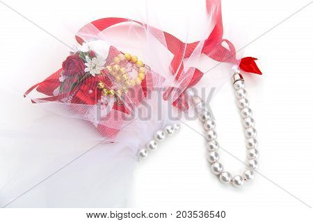 beautiful pillow with golden beads bracelet rings for dog wedding and bride accessories isolated on white background. copy space.