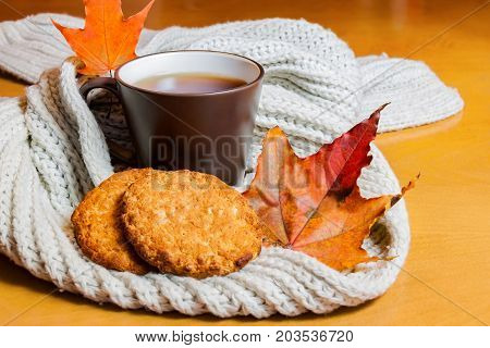 Cup of tea and cookies on wooden table