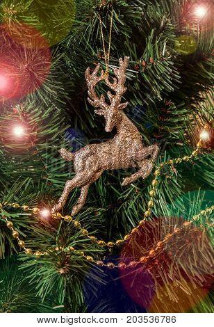 Christmas decoration deer hanging on christmas tree