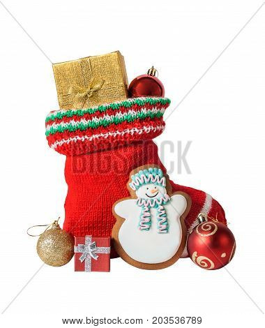 Christmas stocking with gifts gingerbread cake and balls isolated on white background