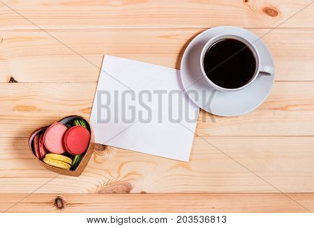 Blank card with space for your text heart shape gift box with macaroons and coffee cup