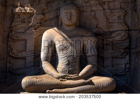 Statue of meditating Buddha, which depicts the dhyana mudra, shows signs of Mahayana influence. Gal Viharaya in Polonnaruwa, Sri Lanka