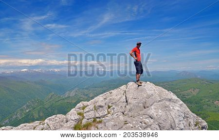 man standing on mountain top, aerial view