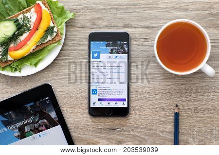 Alushta Russia - May 24 2017: iPhone and iPad on the table with social networking service Twitter on the screen. iPad Pro was created and developed by the Apple inc.