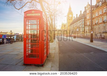 London England - Traditional Old British red telephone box at Victoria Embankment with Big Ben at background