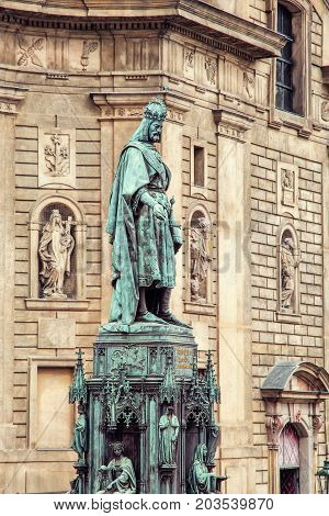 Old statue of Charles IV and St. Francis of Assissi church Prague Czech republic. Architectural theme. Photo filter.