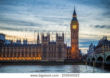 London England - The famous Big Ben Houses of Parliament and Westminster Bridge at dusk
