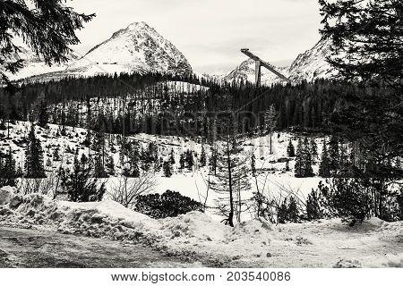 Solisko peak with springboard for ski jumping Strbske pleso Slovak republic. Winter mountains. Black and white photo.