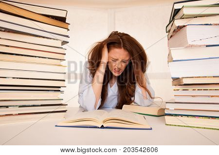 Attractive Young Woman Student Undre Stress While Studiing For Exames