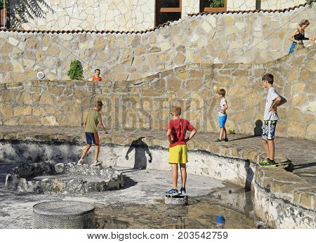 Eger Hungary - July 2 2017: people are playing on the place of empty fountain in Eger Hungary