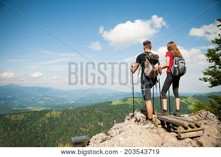 Active Beautiful Young Couple Hiking Ina Nature Climbing Hill Or Mountain - Man And Woman Trekking