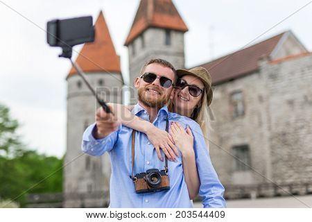 Travel Concept - Happy Tourists Taking Photo With Smart Phone