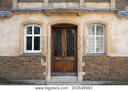 LONDON, UK - 25 August, 2017: Entrance door of old house in Kensington.  Facade of residential buildings in the Kensington, one of the most expensive places to live in UK. Gloucester street.